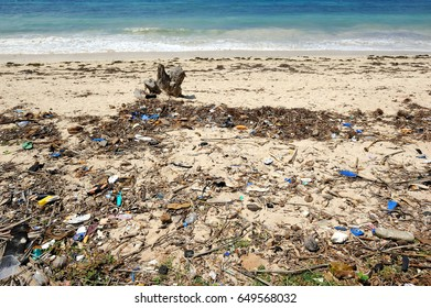 2aef94043c8 Trash on beach. Waste on the sands causes environmental pollution