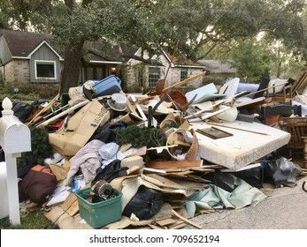 Trash pile of damaged house hold items due to flooding in Houston, Texas from Hurricane Harvey (2017)