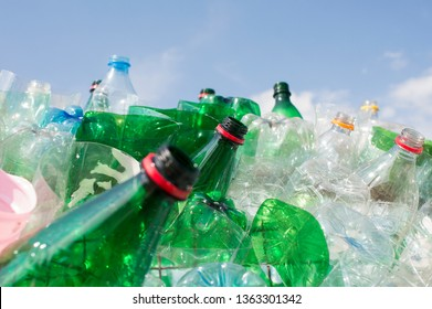 trash pile of empty plastic bottles