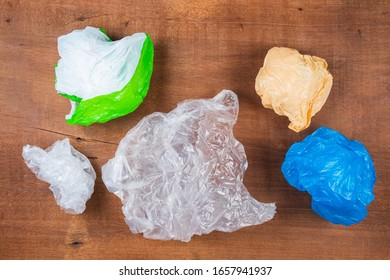 Trash plastic bags on wood board, reuse and reduce plastic concept