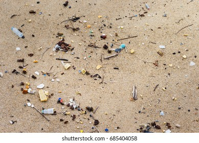 Trash plastic bottle pollution at sandy beach seashore resort