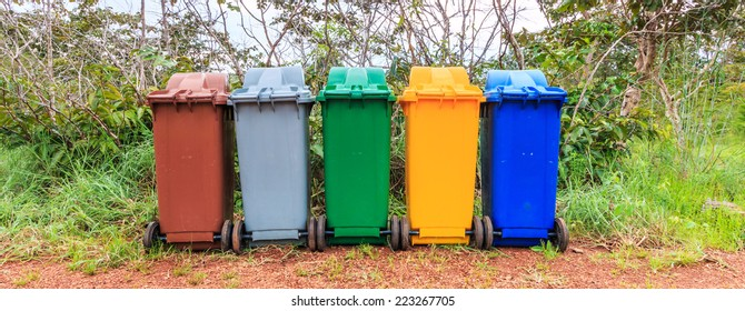 Trash recycling container ecology concept, with landscape background