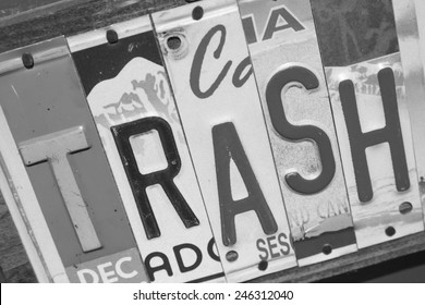 Trash sign made out of state license plates pieced together