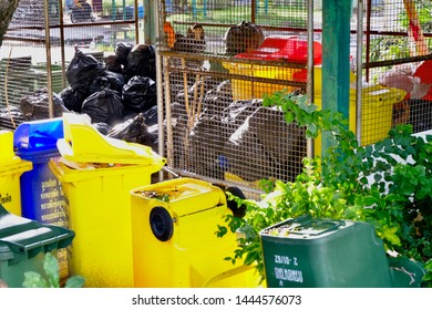 Trash store full of bags and trashcans in the open area these are in Southeast Asia Bangkok Thailand July 6 2019,messy discarded staff preparing for recycling