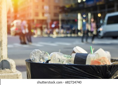 Trash waste bin on new york city street with people and copyspace.