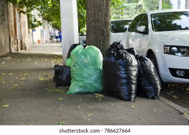 Trashs in public place on street. Food waste packed in plastic bags on roadside. Garbage methane air harmful to health