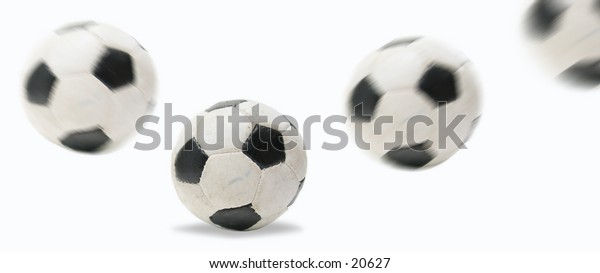 Trasition of a soccer ball bouncing, ball on the ground is in focus.