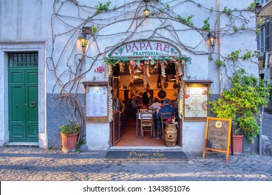 Trastevere, Rome - April 10, 2017: Historic trattoria Papa Re opened in 1935, where it is said that the famous wine of Frascati was made to drink high incognito prelates.