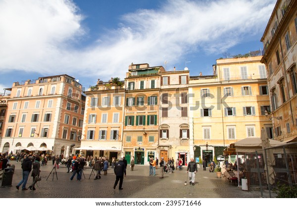 TRASTEVERE IN ROME, ITALY - FEBRUARY 23, 2014: it is a rione of Rome; it maintains its character thanks to its narrow cobbled streets lined by medieval houses, squares, and people walking on the city