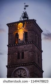 Trastevere, Rome, Italy - March 2018. Santa maria in trastevere Tower at sunset.
