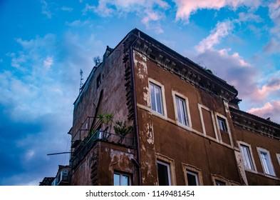 Trastevere, Rome, Italy - March 2018. Ancient Building in trastevere under sunset light.