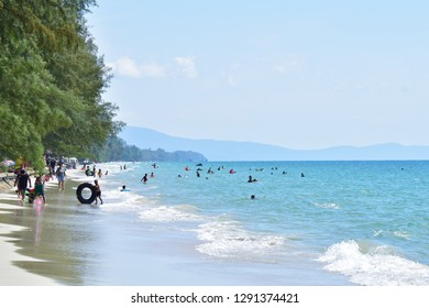 Trat, Thailand - January 01, 2019: Tourists are playing the sea on a beautiful beach at Ban Chuen Beach in Trat, Thailand.