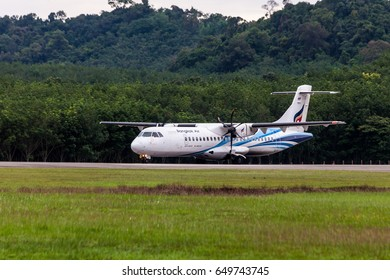 Trat Thailand 30 May 2017: Bangkok airways with ATR72-600 from Bangkok was taxing back to the Trat airport which many of tree near the airport