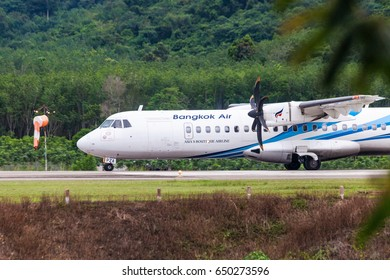 Trat Thailand 30 May 2017:  Bangkok airways with ATR72-600 from Bangkok was taxiing from the end of runway to terminal of the Trat airport which many of tree near the airport