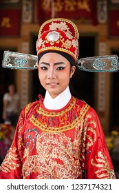 Trat, Thailand - MARCH 11, 2011: Portrait of a beautiful chinese opera actress with face painting. Close-up, blurred backgrounds. Trat Province.