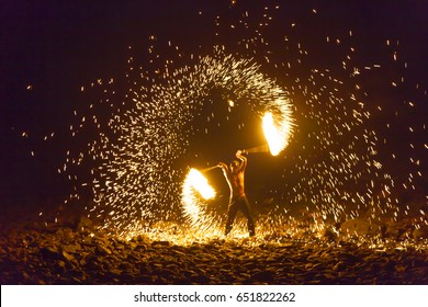 Trat, Thailand - May 16, 2016: Show spinning fire on Lonely beach of Koh Chang (Chang island) at Winter Sensation festival.
