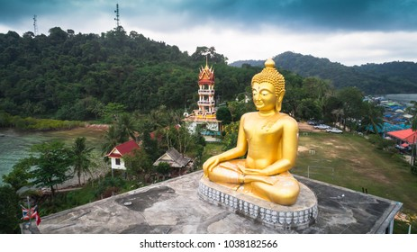 TRAT,THAILAND - MARCH 1;2018: The aerial view village and golden buddha statue at Ban Aosalat in Koh Kut.