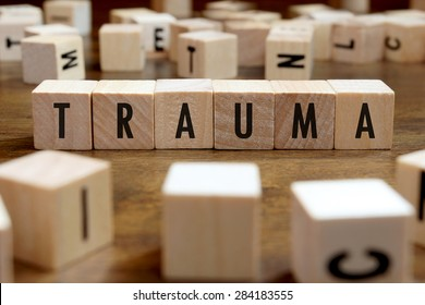 trauma word written on wood block