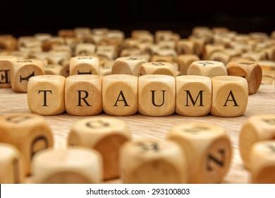 TRAUMA word written on wood block