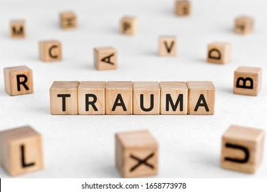 Trauma - words from wooden blocks with letters, physical or mental injury trauma concept, white background