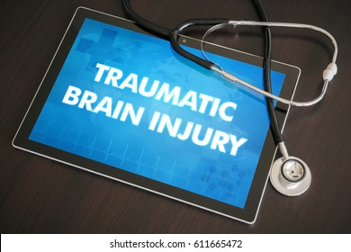 Traumatic brain injury (neurological disorder) diagnosis medical concept on tablet screen with stethoscope.