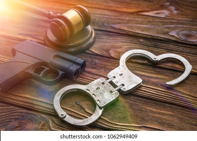 traumatic gun, hammer of the judge. Crime, robbery with the help of traumatic weapons, responsibility. committal and punishment, court and law