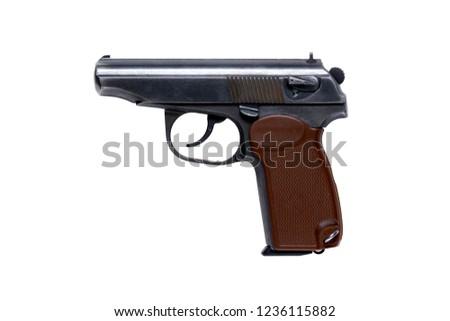 Traumatic pistol on white