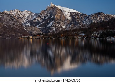 Traunkirchen at dusk with reflection in the water