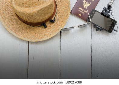 Travel accessories and costume on white wooden floor