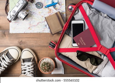 Travel accessories costumes. Passports, luggage, camera, sunglasses, boot, sneaker, The cost of travel maps prepared for the trip