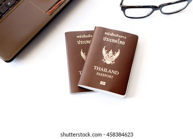 Travel accessories costumes. Passports, Preparation for travel, glasses, and laptop for vacation time, soft focus.