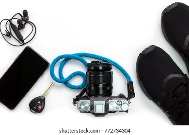 Travel accessories such as camera , sneaker , mobile phohe isolated on white background