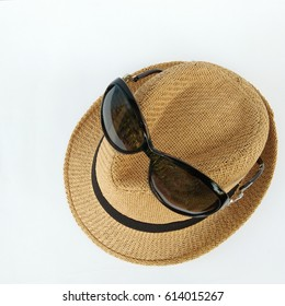 Travel accessories with sunglasses on hat. Sunlight protection items on white background.