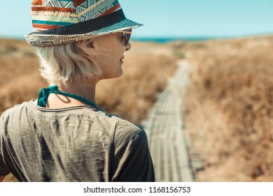 Travel Adventure Hiking Woman Concept. Outdoor summer sunny fashion portrait of pretty woman