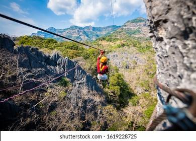 Travel, adventure, mountain climbing, Zipline Laos the rock viewpoint at phou pha marn.focus all
