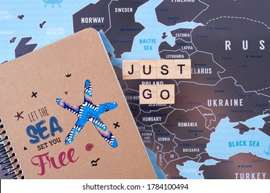 Travel agency advertisement idea. Notepad with let the sea set you free slogan. Just go slogan.
