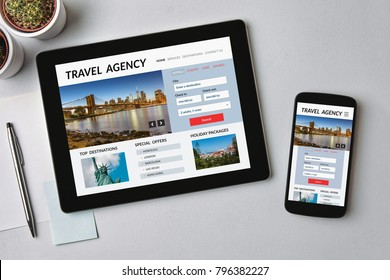 Travel agency concept on tablet and smartphone screen over gray table. All screen content is designed by me. Flat lay