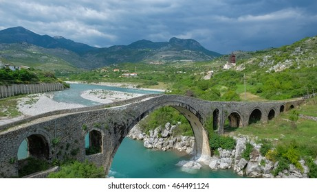 Travel Albania - Old ottoman bridge across the river color of blue in Albania.