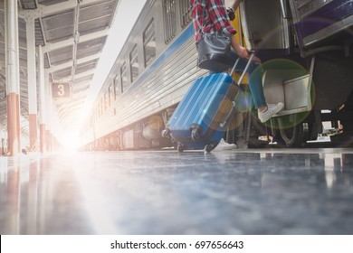 Travel alone concept. Young woman be brave to solo travel and step up to the train at train station