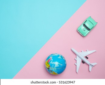 Travel around the world for your colorful life .Enjoy the funny trip journey .Top view for copy space some idea your create destination .object  cute  car ,world  vintage,airplane  on color background
