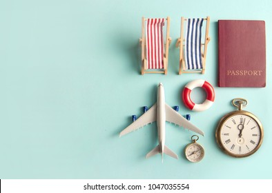 Travel assessories including miniature sun deck chair, airplane, clock and passport with space