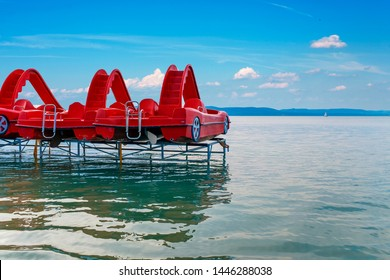 Travel background of red pedal boats on a pier at lake Balaton in Hungary