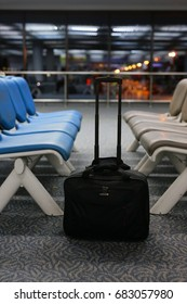 Travel bag in airport waiting for call