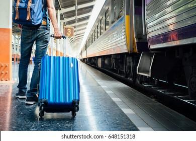 travel bag, hand holding bag on the Train station