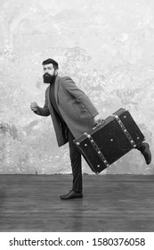 Travel and baggage concept. Hipster traveler with baggage. Ready for relocation with baggage. Start journey. On way to new life. Luggage insurance. Man well groomed bearded hipster with big suitcase.