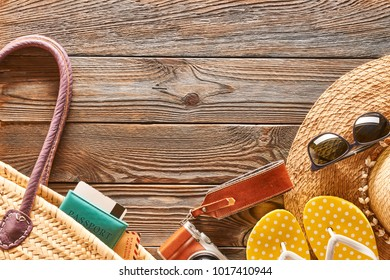 Travel and beach items still life over wooden background