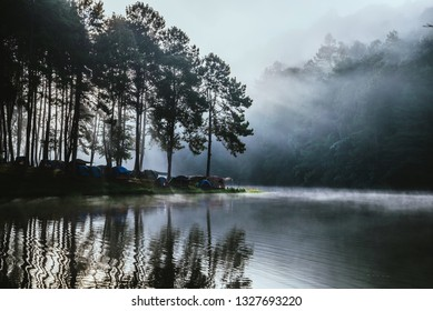 travel  Beatiful nature panorama view of Pang Ung lake in the mist at sunrise.
