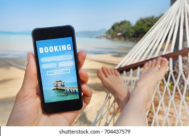 travel booking, hotels and flights reservation on the screen of smartphone