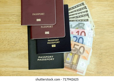 Travel budget. Collect money for travel, photo of passport and foreign currency dollar, euro. Top view with Wood background