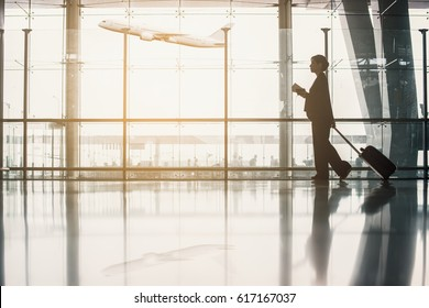 Travel, Business, Advertise concept - Asian businesswoman with luggage holding passport and boarding pass in airport terminal and airplane flying on background. (vintage color tone image)